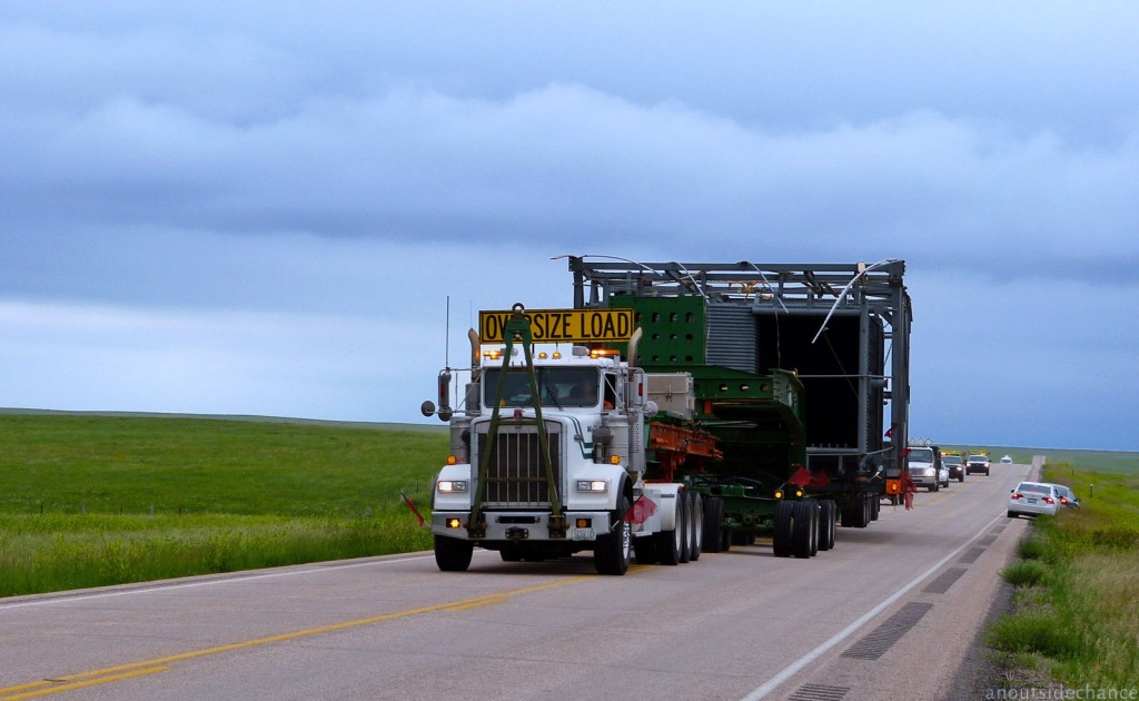 State Highway 73 near Faith, South Dakota. I was happy to dismount and get off the road to let this truck pass. June 18, 2014.