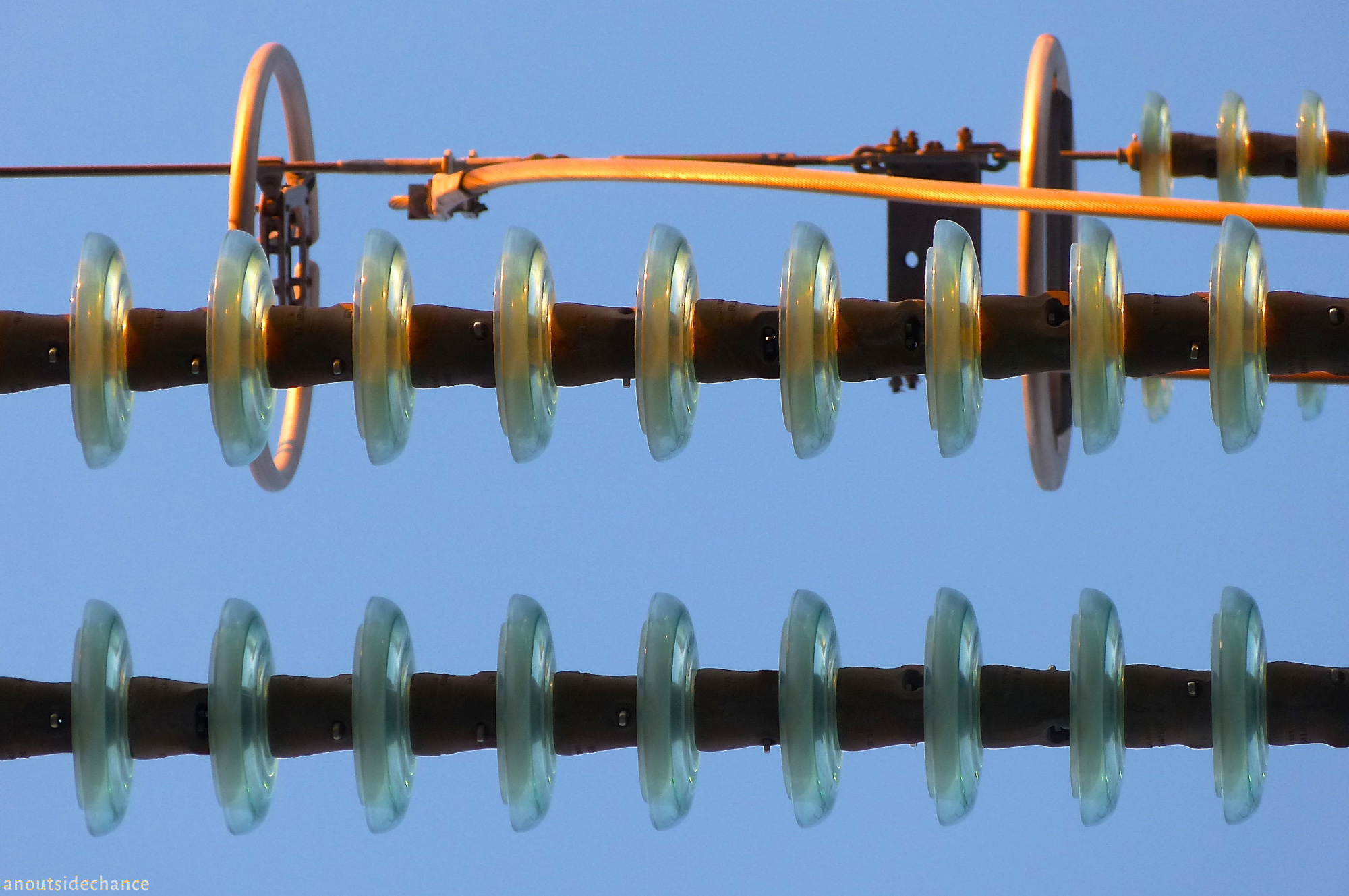 Insulators on high-voltage electricity transmission line.