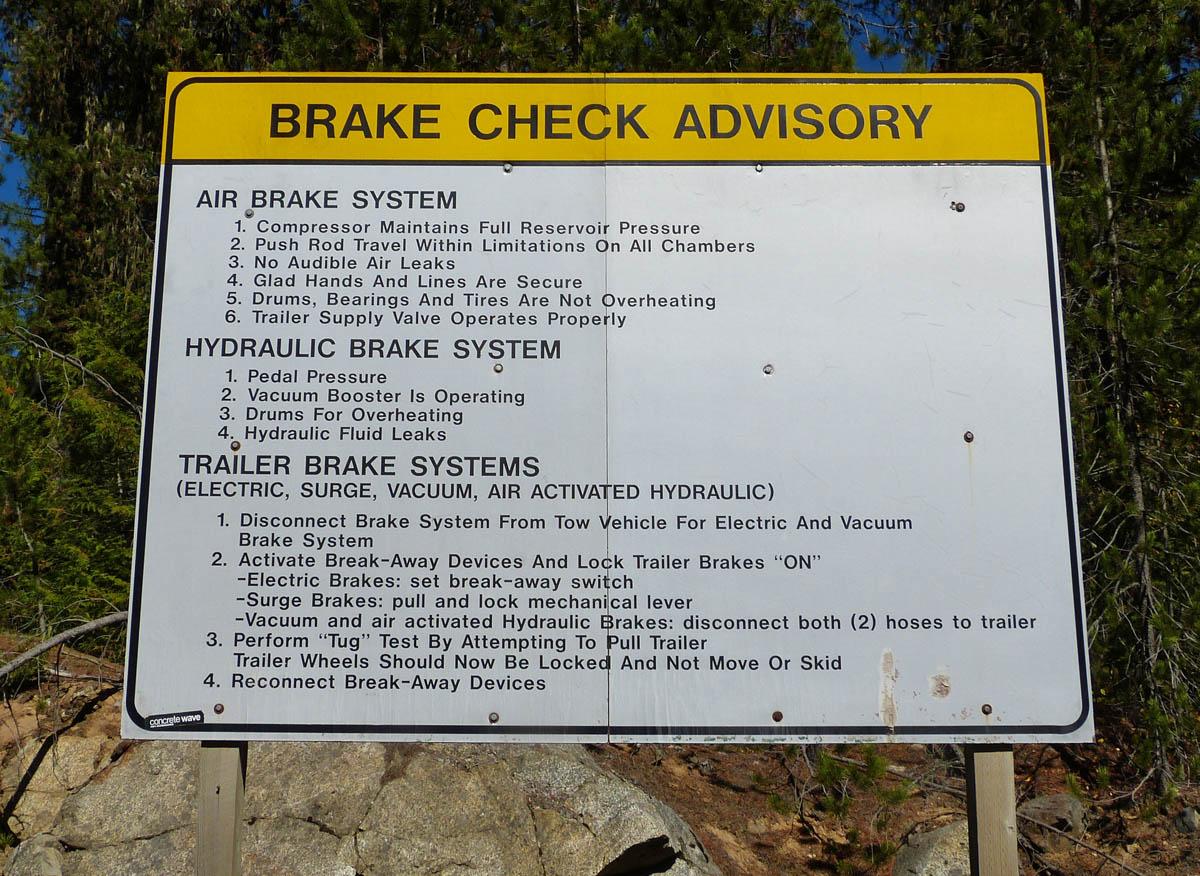 Brake Check Advisory sign.