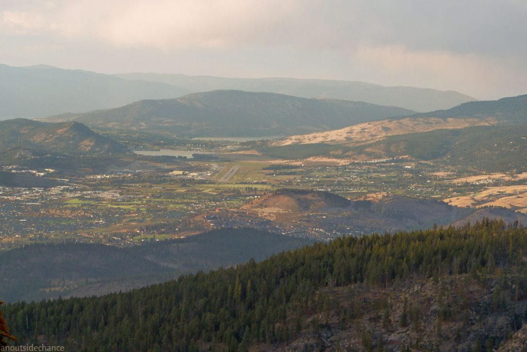 View from Kettle Valley Rail Trail of eastern outskirts of Kelowna, including airport.